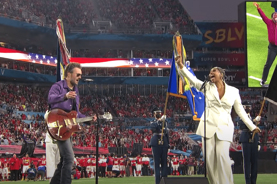 Jazmine Sullivan and Eric Church sing the National Anthem for the Super Bowl LV pre-game show on February 7, 2021. | Source: YouTube/NFL