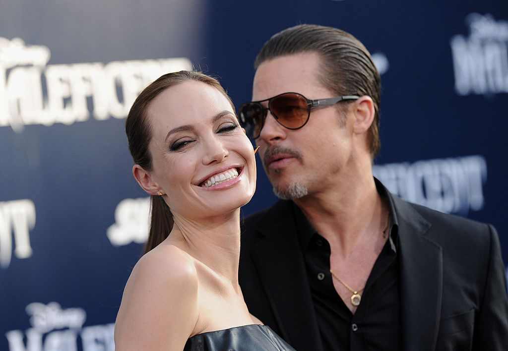"""Angelina Jolie and Brad Pitt at the World Premiere of Disney's """"Maleficent"""" at the El Capitan Theatre on May 28, 2014, in Hollywood, California 