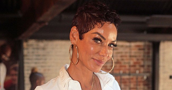 Nicole Murphy Flaunts Toned Legs in a White Swimsuit and High-Heels —Here's the Hot Snap