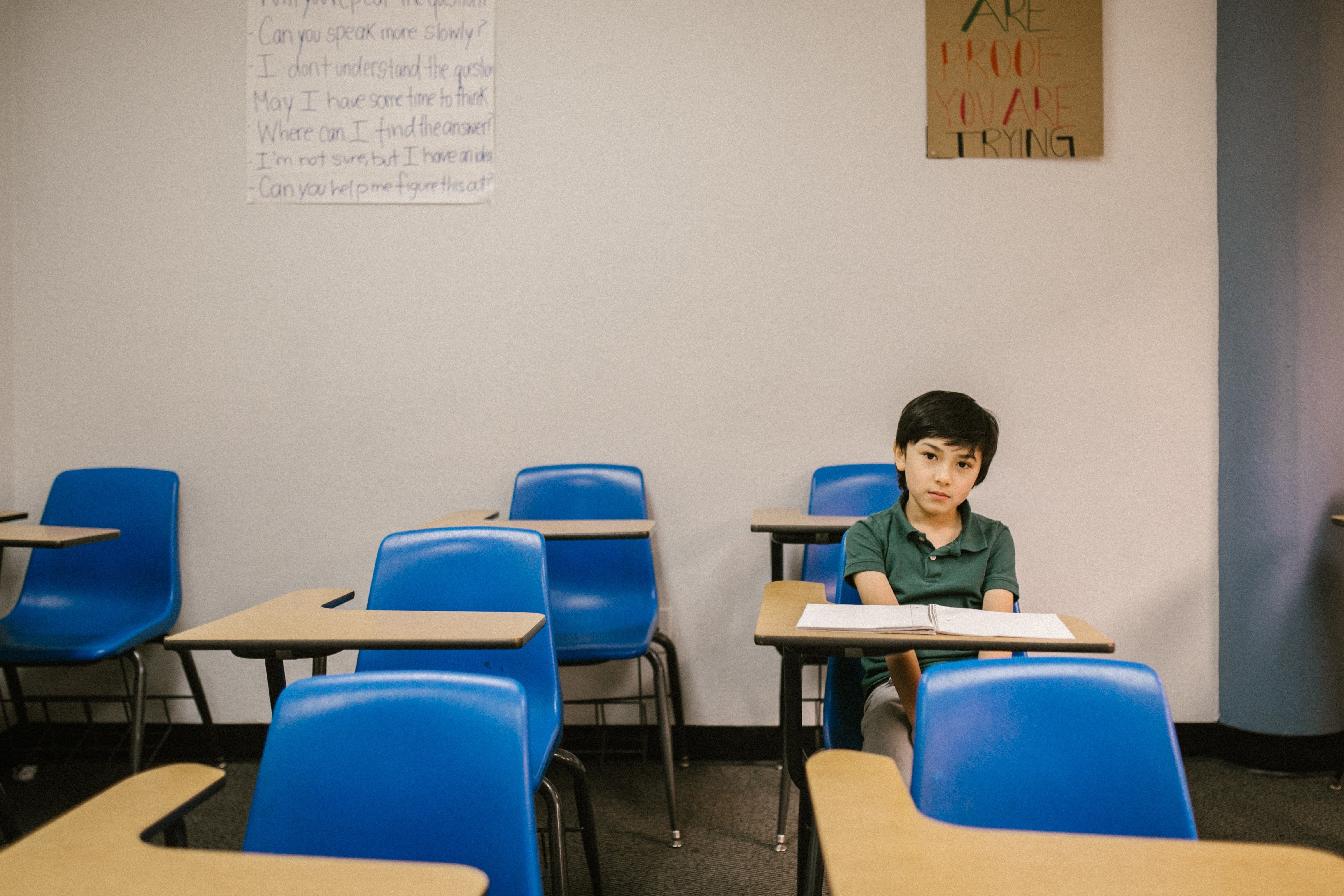 Boy sitting on his desk looking lonely   Photo: Pexels