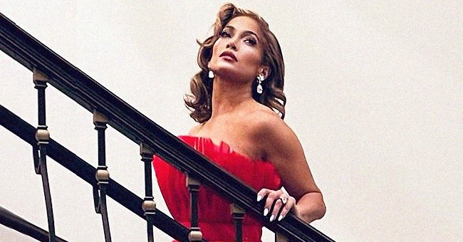 Jennifer Lopez Wishes Fans 'Beautiful Christmas Eve' Posing in Long Red Sleeveless Gown