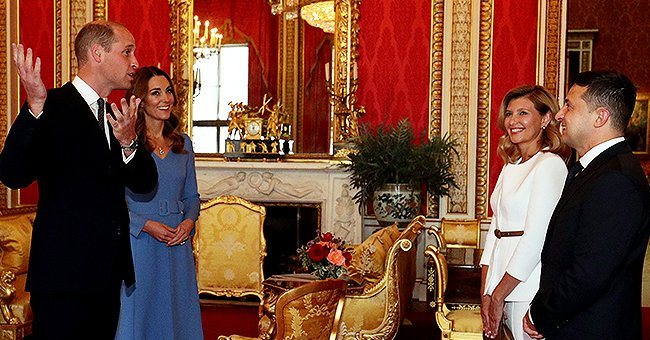 Kate Middleton Steps in for the Queen at Buckingham Palace in an Elegant Belted Blue Dress