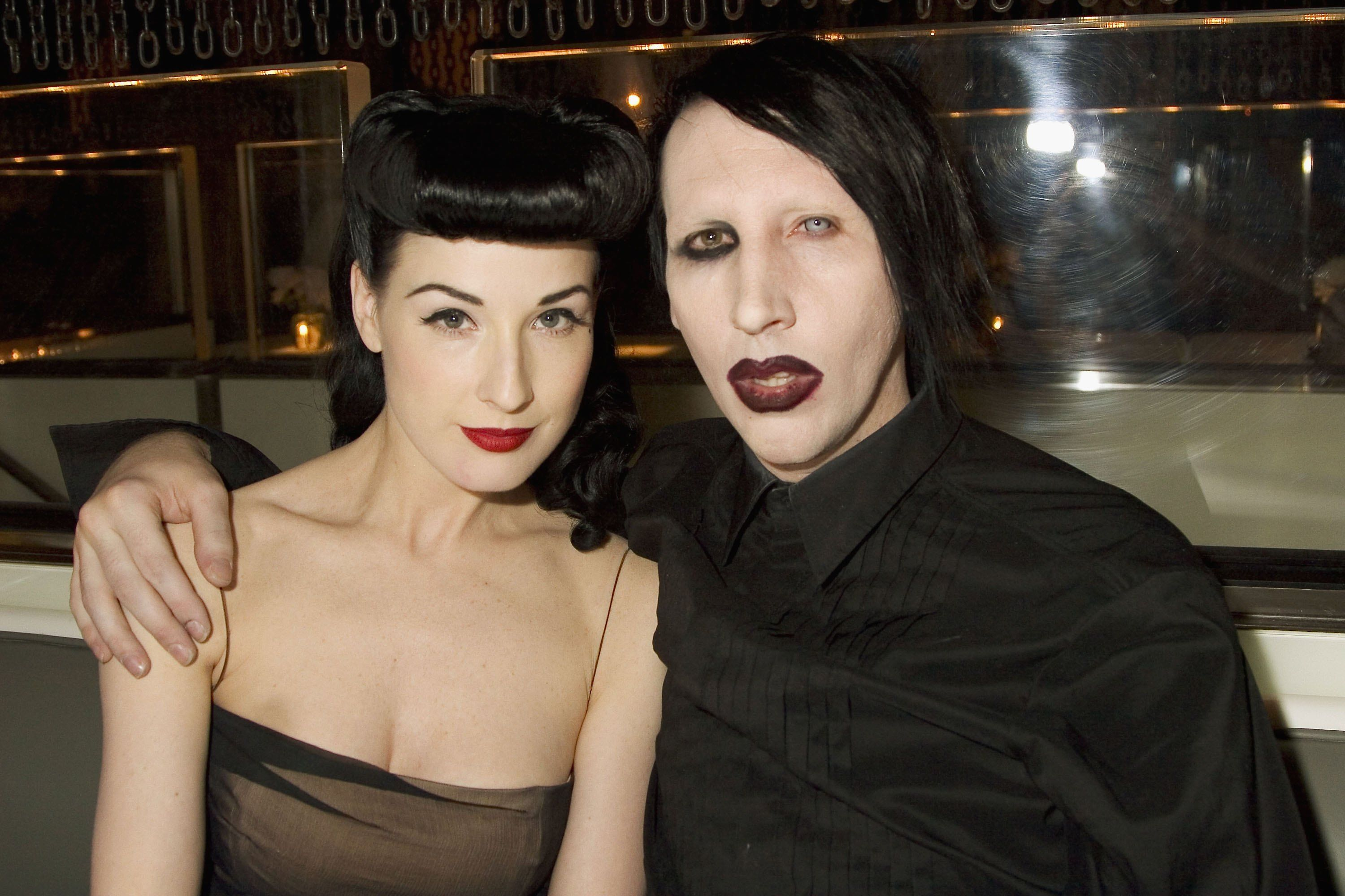 Dita Von Teese and Marilyn Manson atthe opening of MR CHOW Tribeca on May 4, 2006 in New York. | Photo: Getty Images