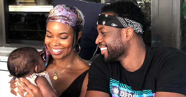 Dwyane Wade Is All Smiles with Baby Kaavia before Stare down during Bottle Feed