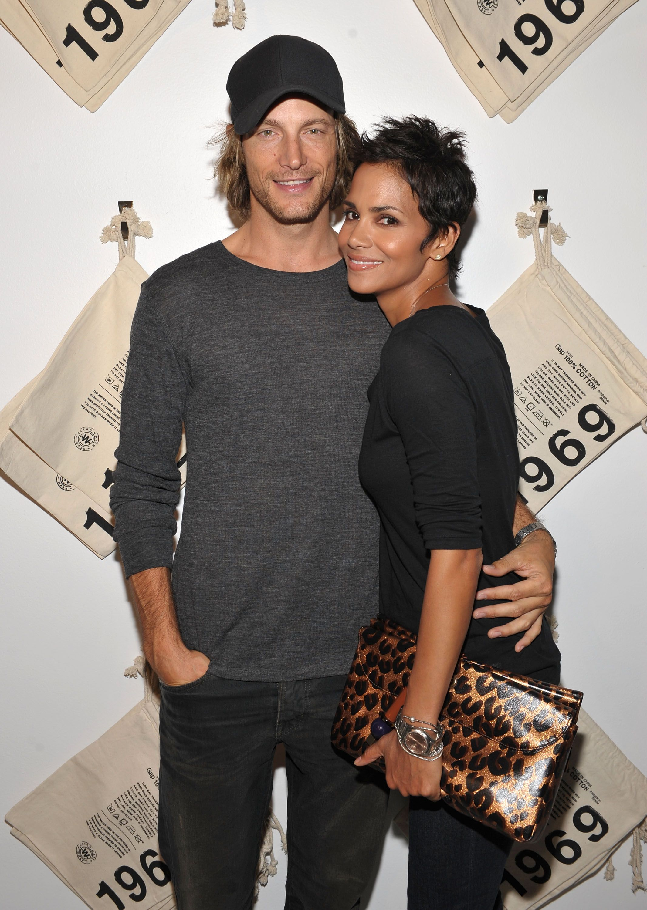 Actress Halle Berry (R) and Gabriel Aubry attend the launch event for Gap's 1969 Jean Shop on Robertson Blvd on August 6, 2009 in West Hollywood, California. | Source: Getty Images