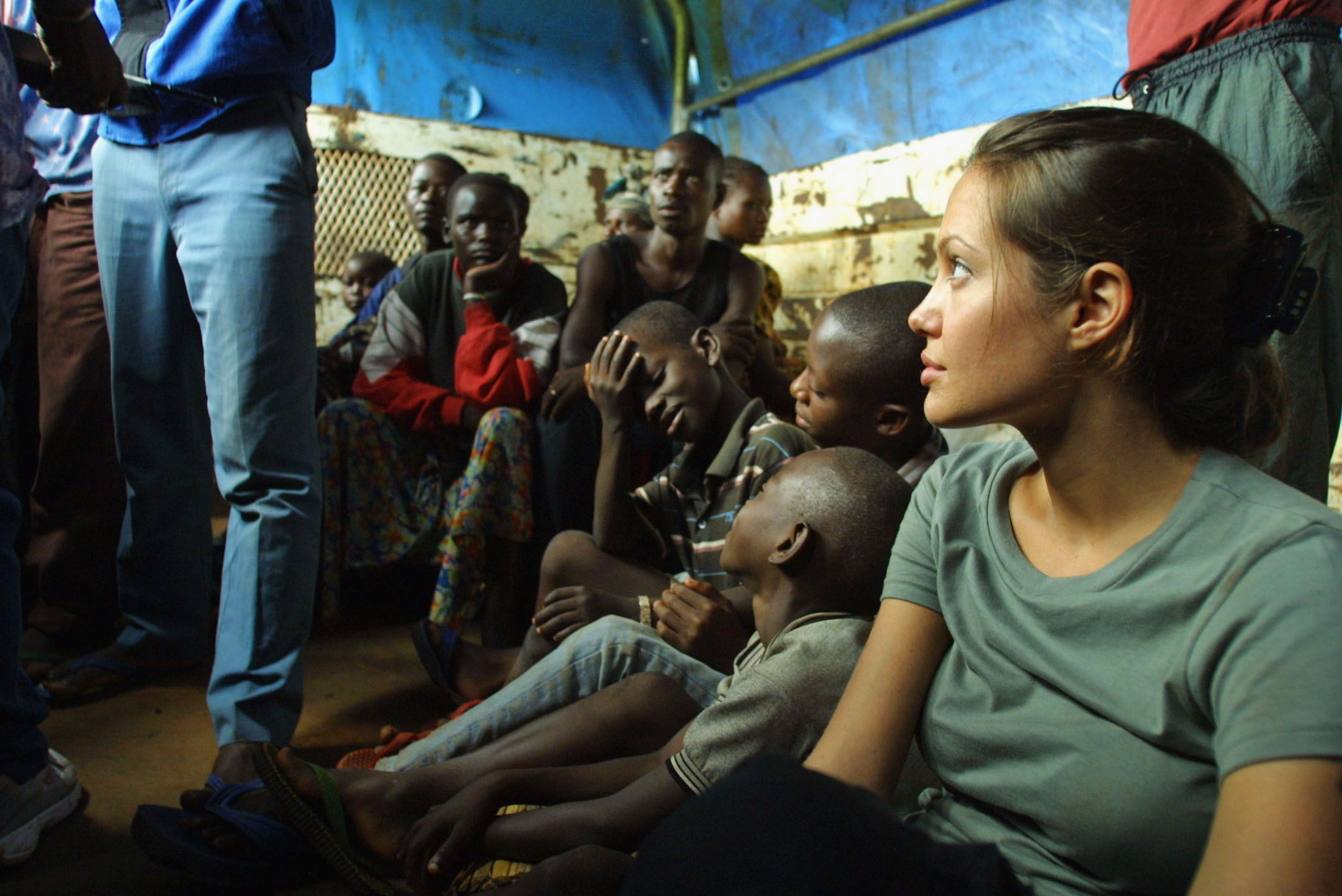 UNHCR Goodwill Ambassador Angelina Jolie on a truck with refugees en route from Kigoma to Lugufu Camp, Tanzania in 2003 | Source: Getty Images