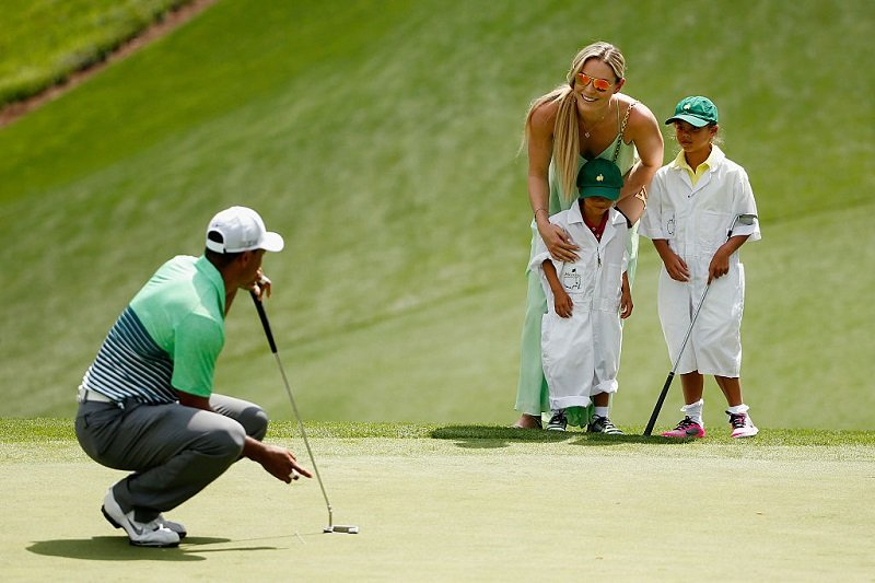 Tiger Woods, his then-girlfriend Lindsey Vonn, his son Charlie and his daughter Sam at Augusta National Golf Club on April 8, 2015 in Augusta, Georgia | Photo: Getty Images