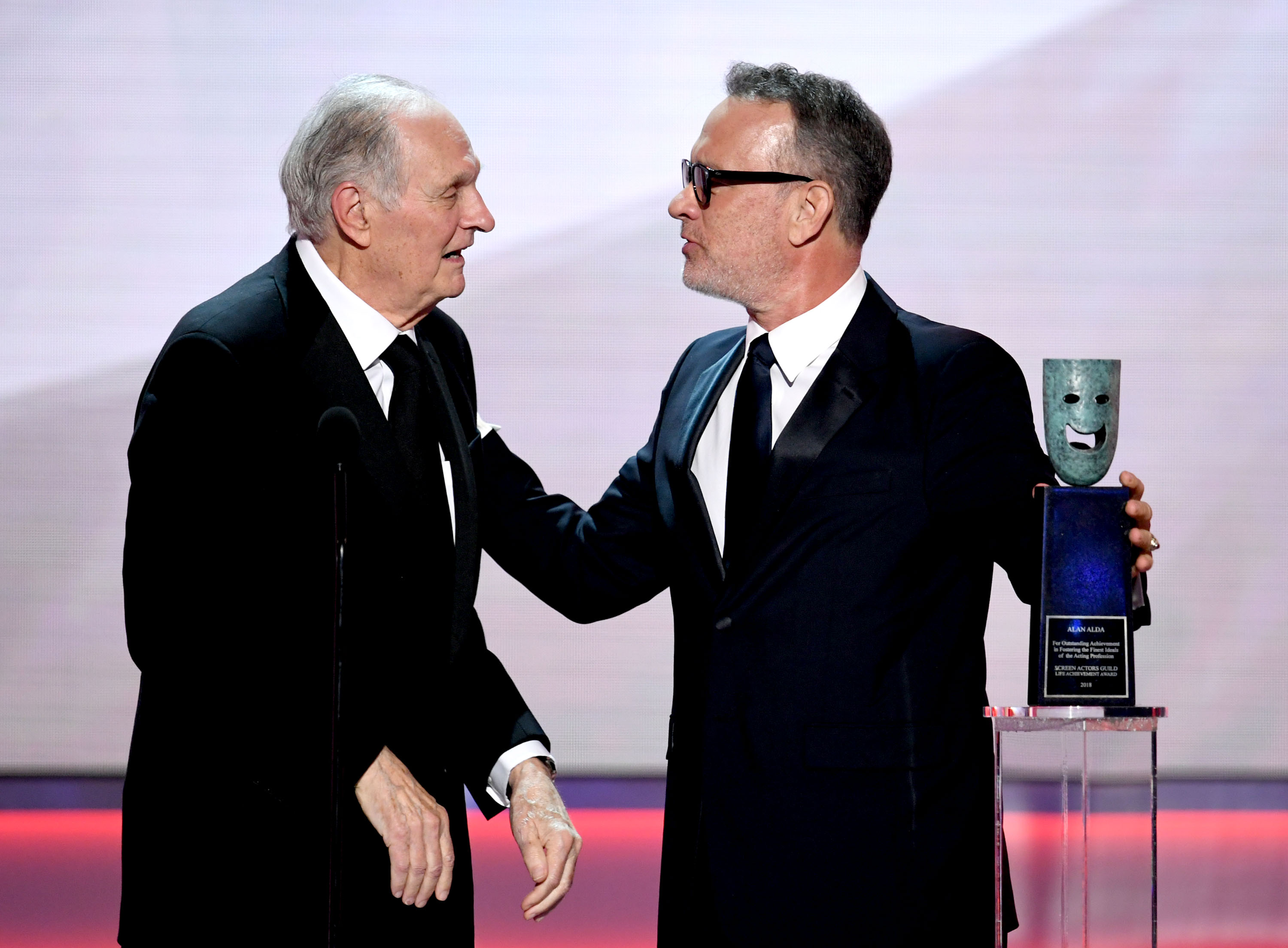 Tom Hanks presents Alan Alda with the 2018 Screen Actors Guild Lifetime Achievement Award. Image Credit: Getty Images