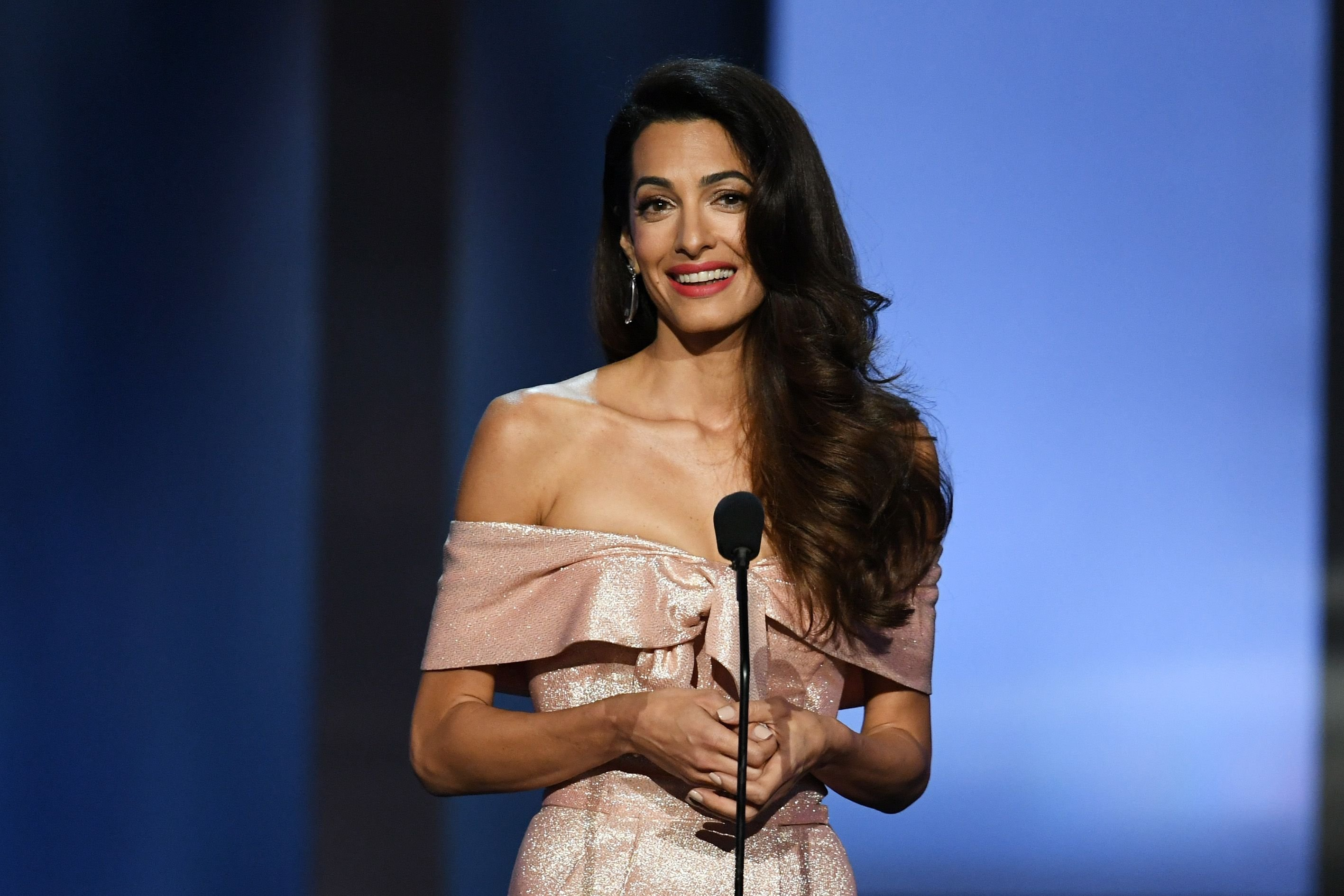 Amal Clooney speaks onstage at the American Film Institute's 46th Life Achievement Award Gala Tribute to George Clooney at Dolby Theatre on June 7, 2018 | Photo: Getty Images