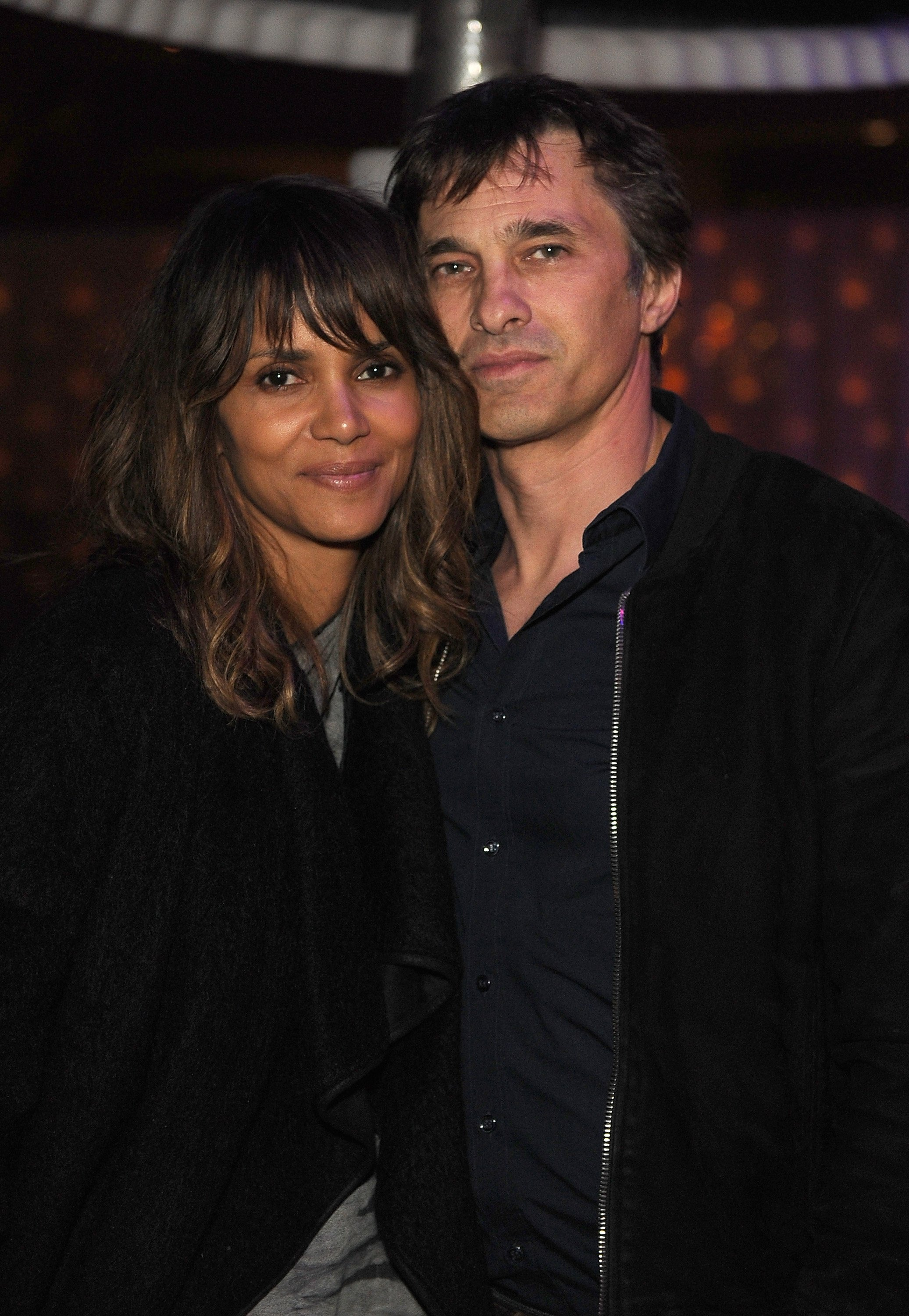 Halle Berry and Olivier Martinez at the Treats! Magazine Pre-Oscar Party at the Treats! Villa on February 21, 2015 in Los Angeles, California. | Source: Getty Images