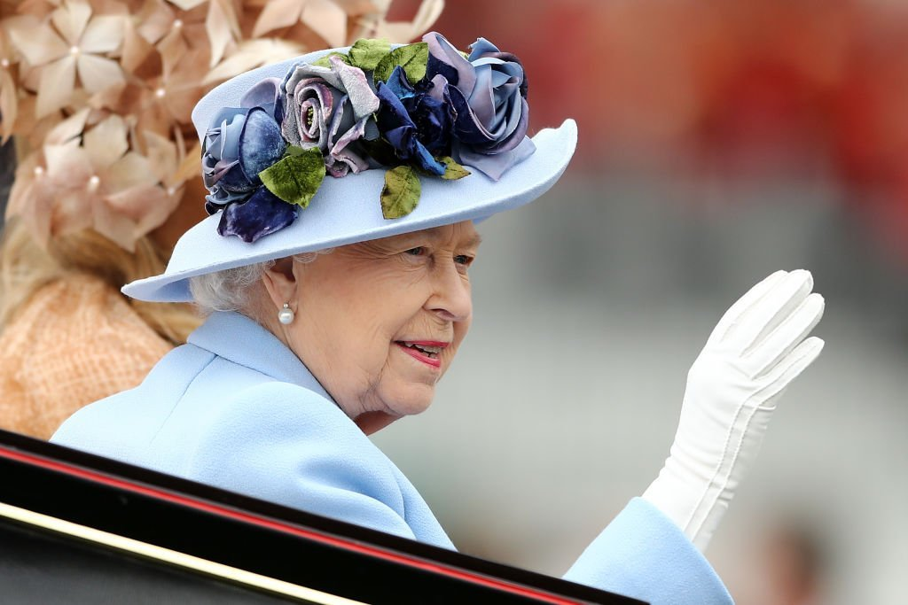 Queen Elizabeth II waves to the crowds as she arrives on day one of Royal Ascot at Ascot Racecourse | Photo: Getty Images