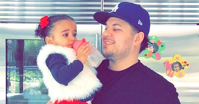 Rob Kardashian Posts Adorable New Snap of Daughter Dream in Pink Swimsuit & Cap Partially Buried in the Sand