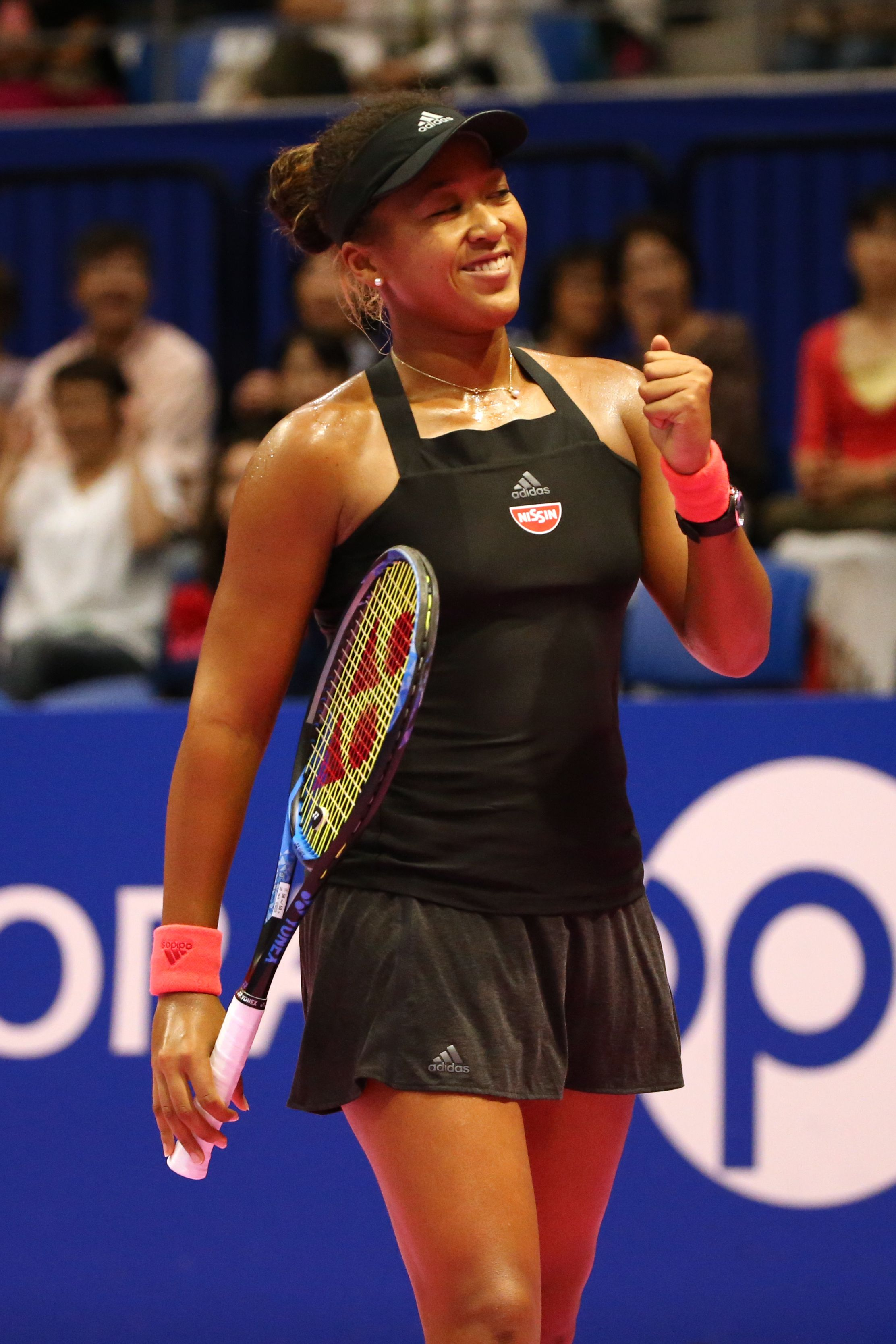 Naomi Osaka celebrating her victory in the singles second round match against Dominika Cibulkova on September 19, 2018 in Tokyo. | Photo: Getty Images