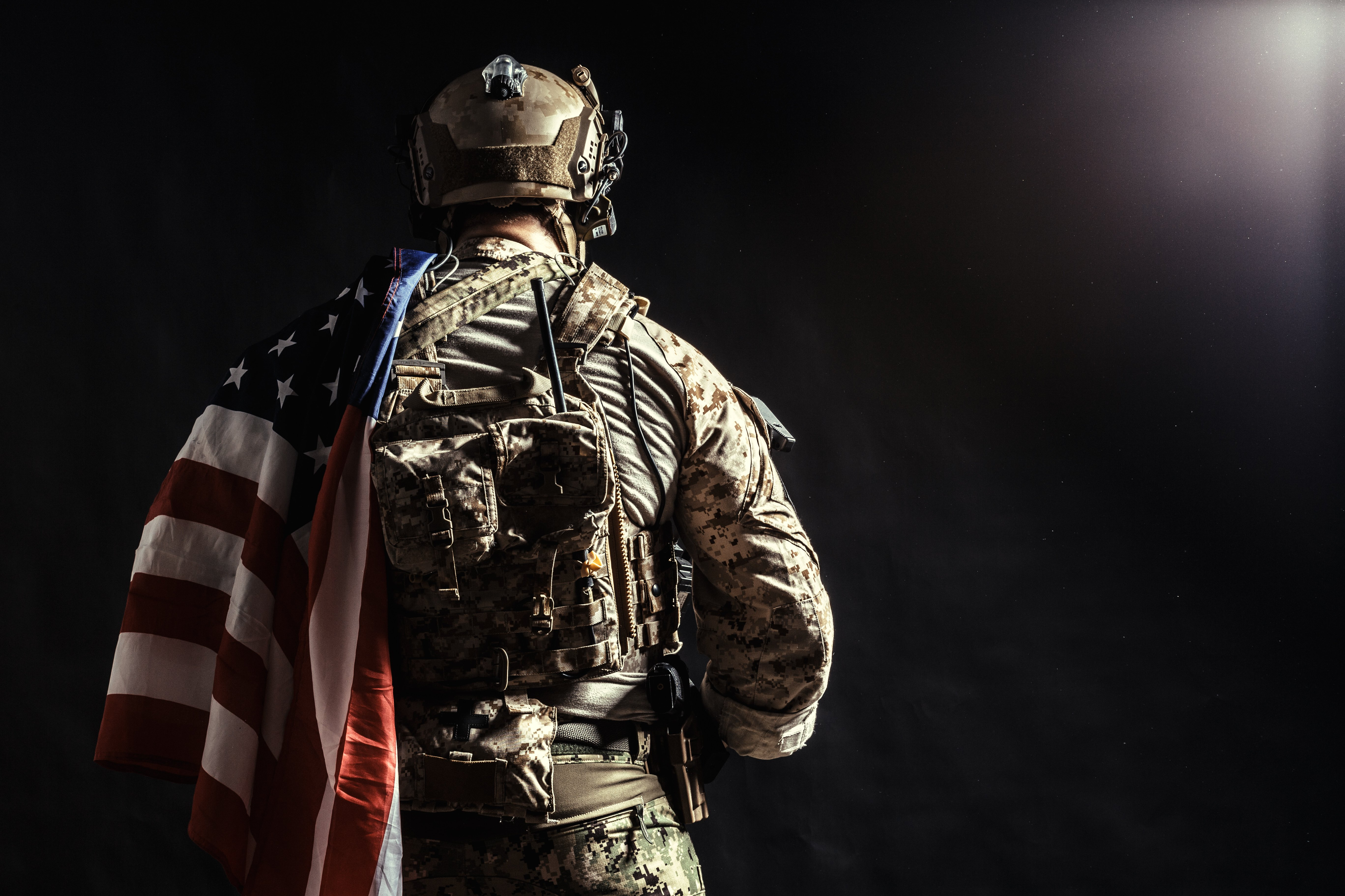 A soldier with the United States of America (U.S.A.) flag on his shoulder. │Source: Shutterstock