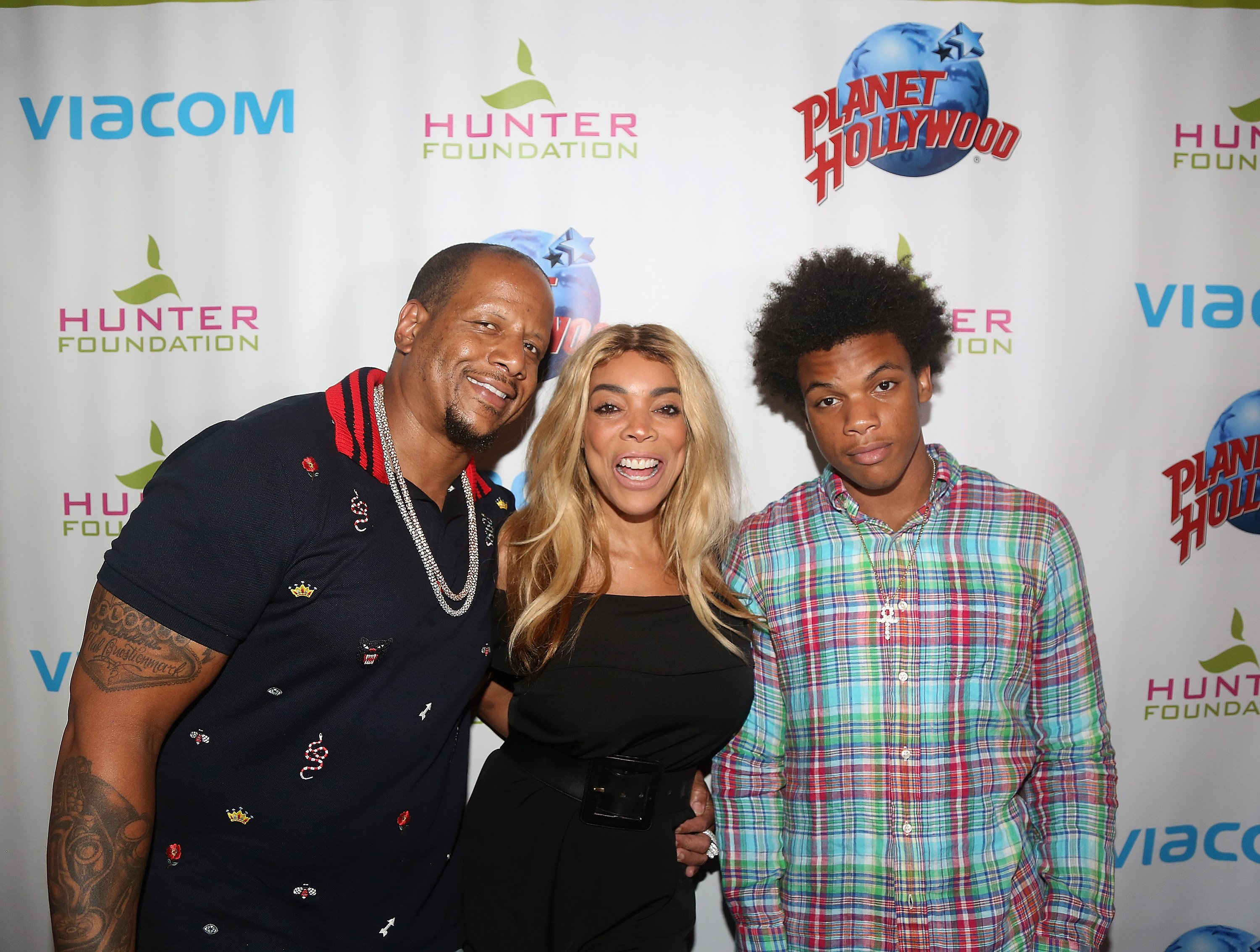 Kevin Hunter, wife Wendy Williams and son Kevin Hunter Jr pose at a celebration for The Hunter Foundation Charity at Planet Hollywood Times Square on July 11, 2017, in New York City. | Source: Getty Images.