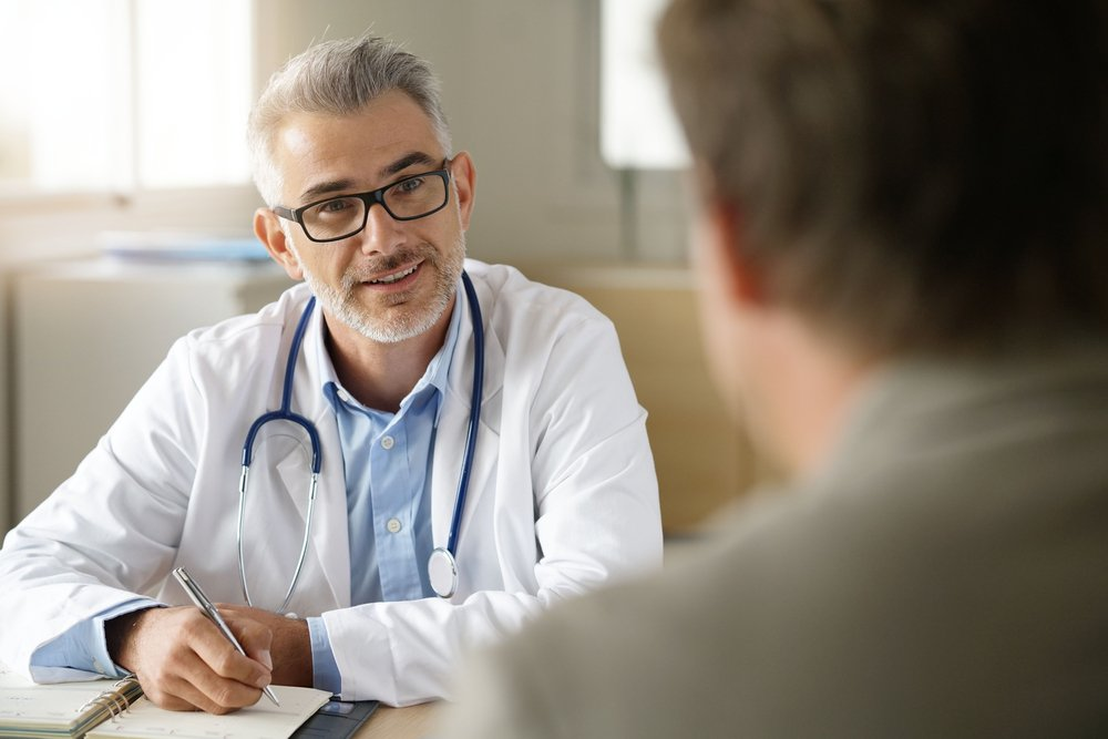 A photo of a doctor during an appointment | Photo: Shutterstock