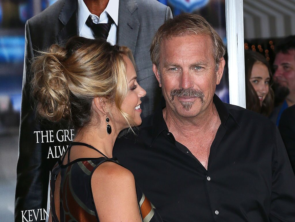 """Kevin Costner and wife Christine Baumgartner at the premiere of """"Draft Day"""" in  2014 