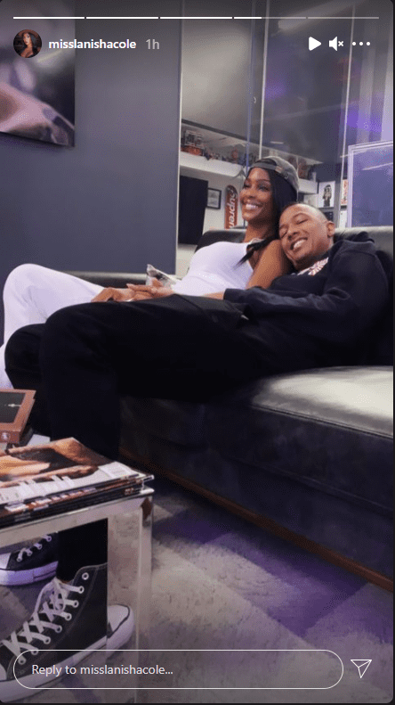 Nick Cannon and LaNisha Cole cuddle up in a sofa. | Source: Instagram/misslanishacole