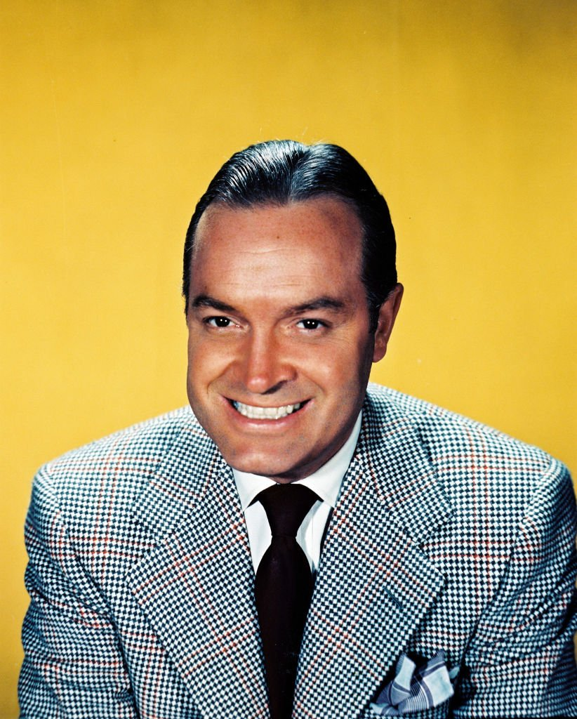 Bob Hope smiled in a studio portrait, against a yellow background on January 01, 1950 | Photo: Getty Images