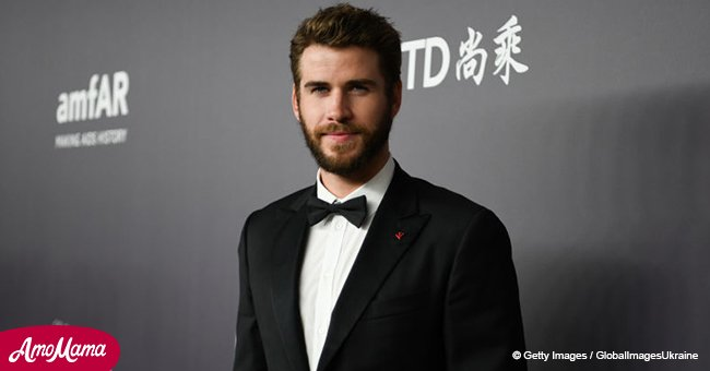 Liam Hemsworth shares photo showing off his abs and workout body in colorful shorts
