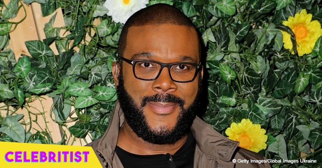 Tyler Perry's girlfriend shows off her toned figure in black, off-the-shoulder mini dress