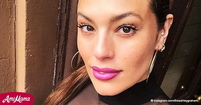 Ashley Graham flashes her curvy figure in clingy one-sleeve dress during a recent appearance