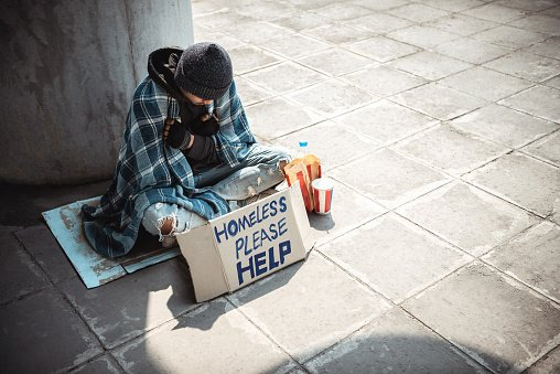 Photo of a young homeless man sitting on the street and begging.   Photo: Getty Images
