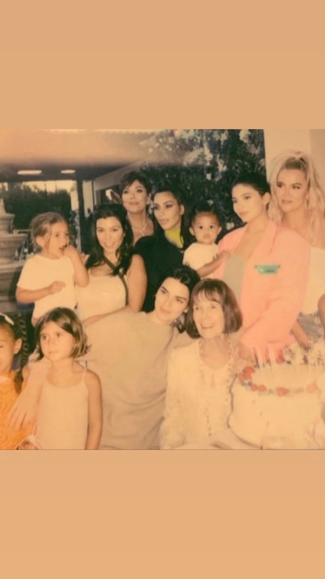 The Kardashian-Jenner family posing with MJ. | Source: Instagram/khloekardashian