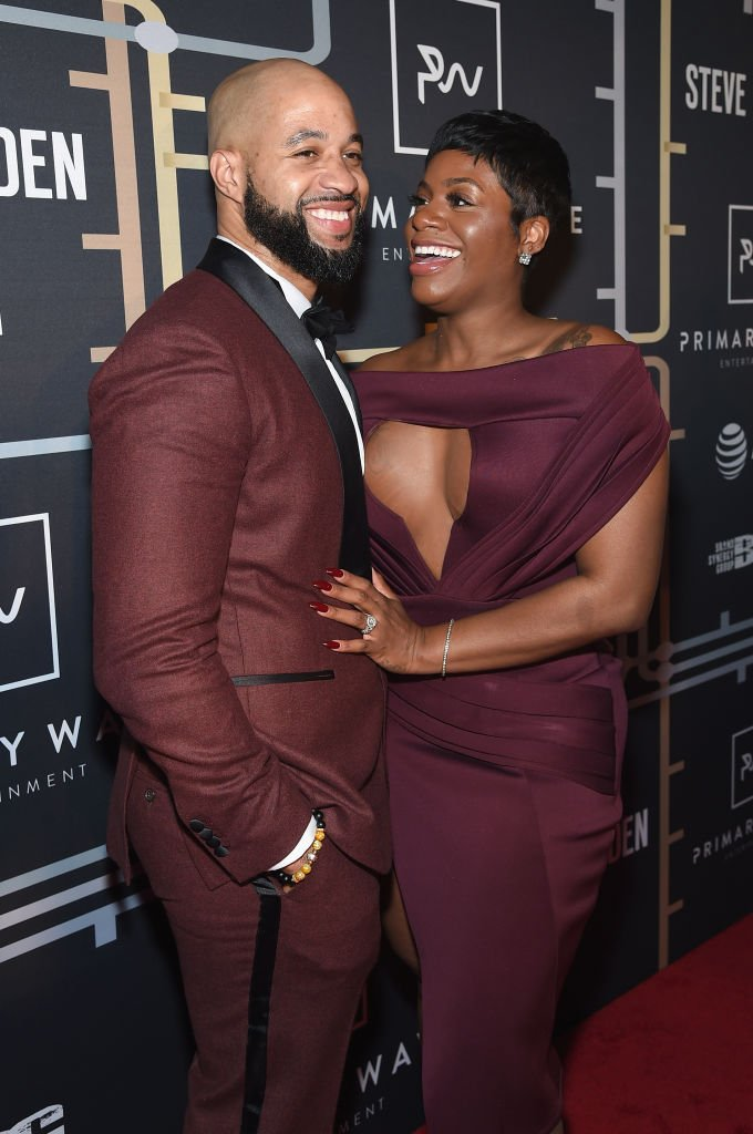 Kendall Taylor shared a laugh with his wife Fantasia Barrino as they posed on the red carpet at th Primary Wave Entertainment's 12th Annual Pre-Grammy Party on January 27, 2018, New York |Source: Jamie McCarthy/Getty Images for Primary Wave Entertainment