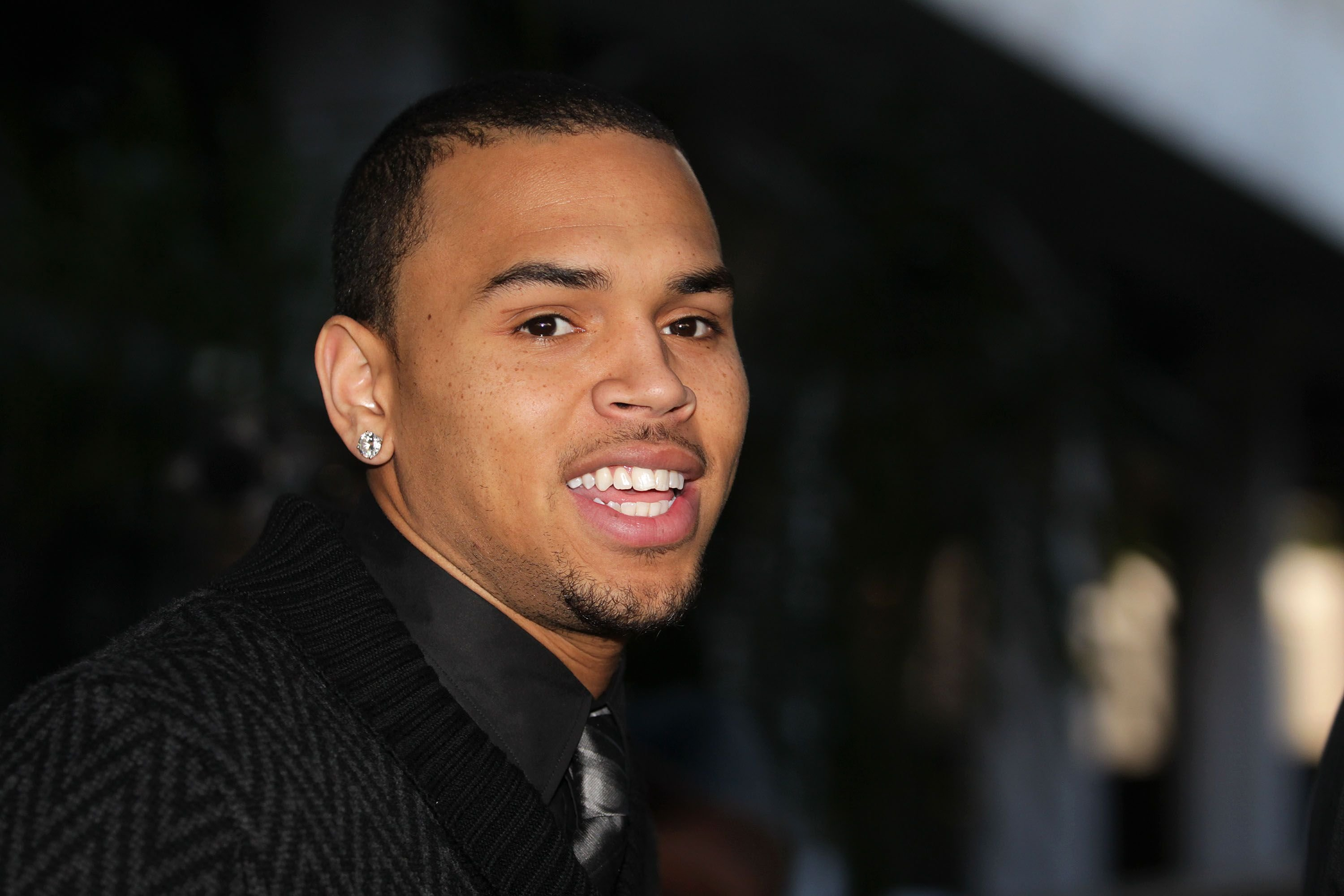 Chris Brown at the Los Angeles courthouse after a probation progress hearing on January 28, 2011 in Los Angeles, California. Brown pleaded guilty to assaulting his then-girlfriend, singer Rihanna, after a pre-Grammy Awards party in 2009. | Source: Getty Images