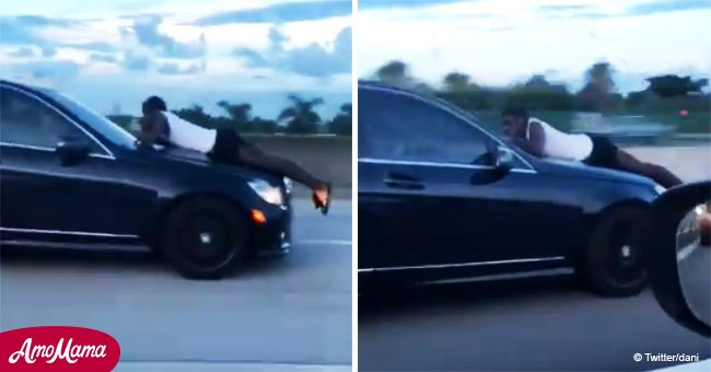 Dramatic moment man makes 911 call while clinging to the hood of a speeding car (video)