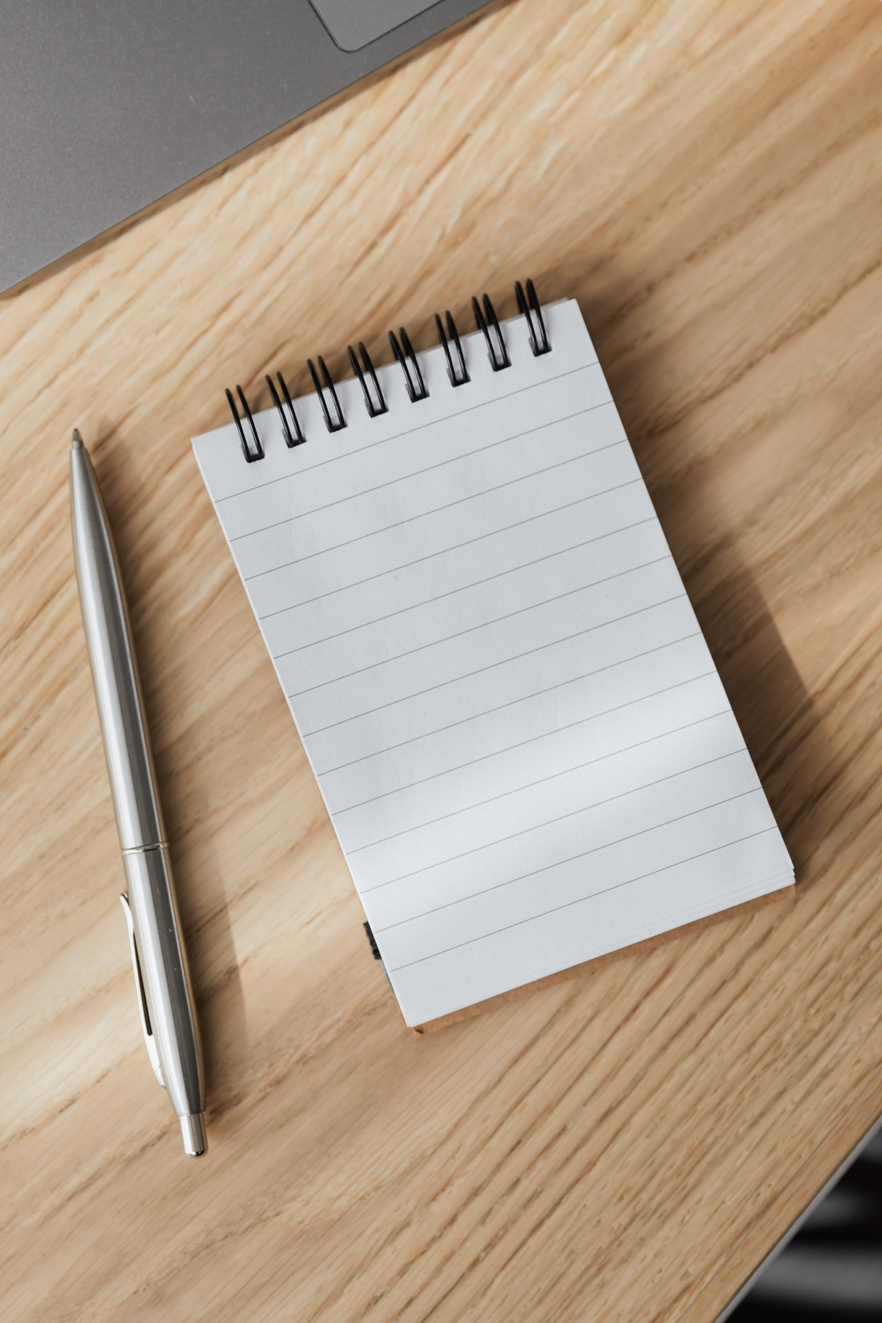 Notebook with a silver pen | Source: Pexels