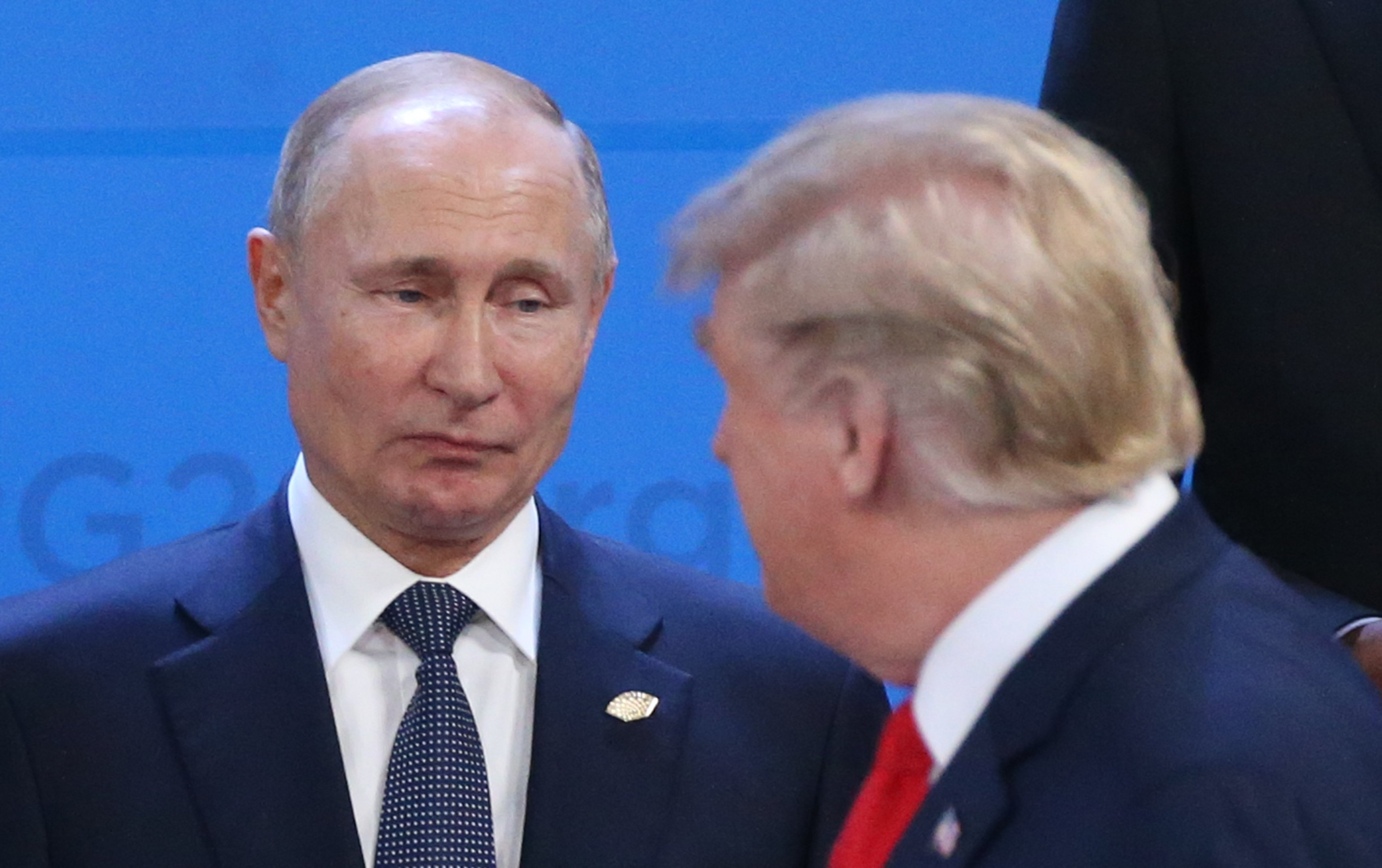 Russian President Vladimir Putin and U.S. President Donald Trump exchange looks during the opening ceremony of the G20 Summit's Plenary Meeting in Buenos Aires, Argentina   Photo: Getty Images