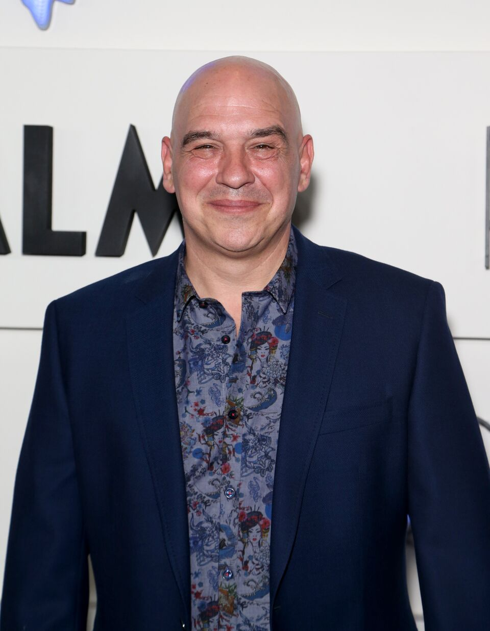 Michael Symon attends the grand opening of KAOS. | Source: Getty Images