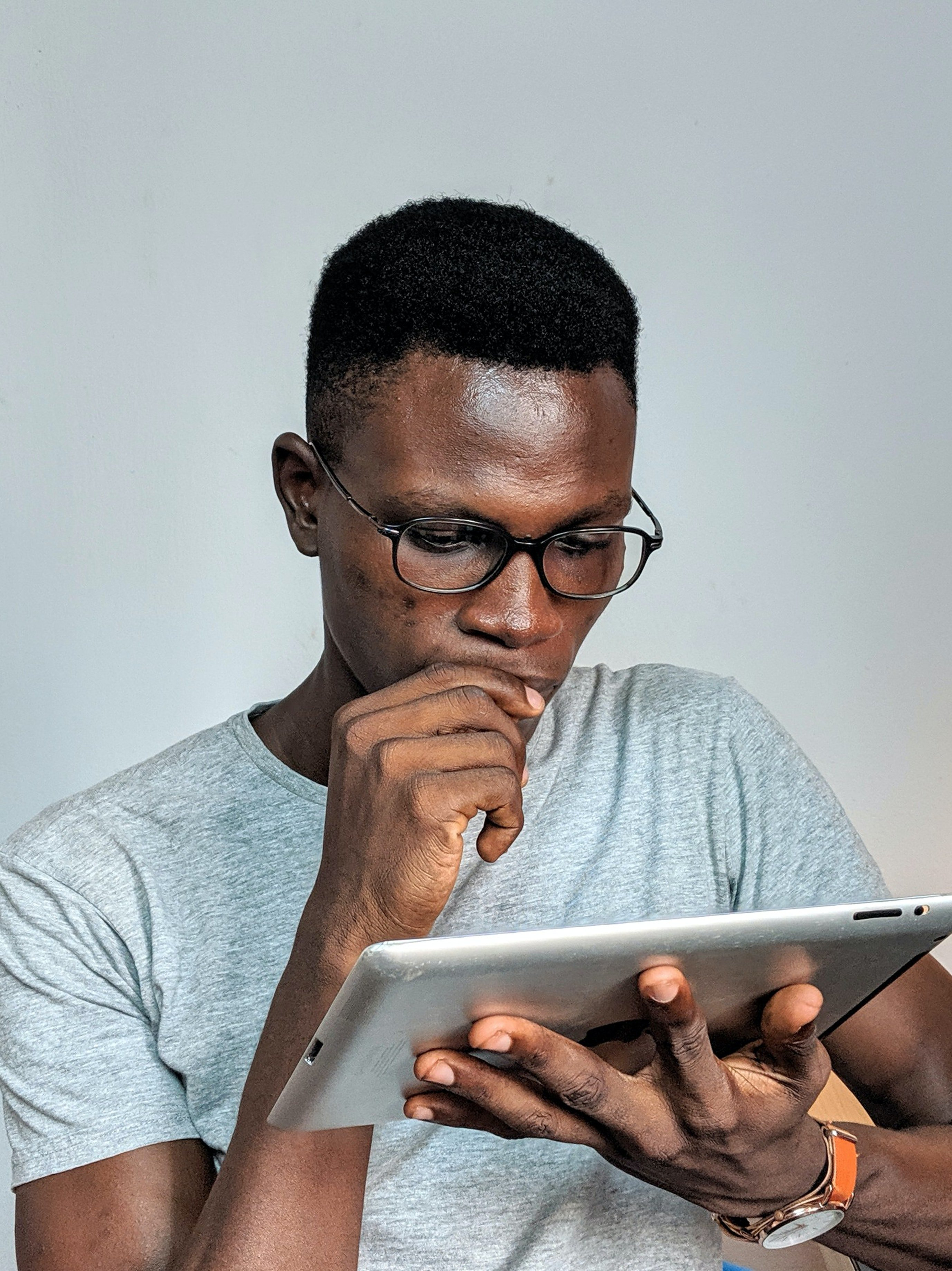 A man looking at an iPad. | Source: Pexels/  Oladimeji Ajegbile