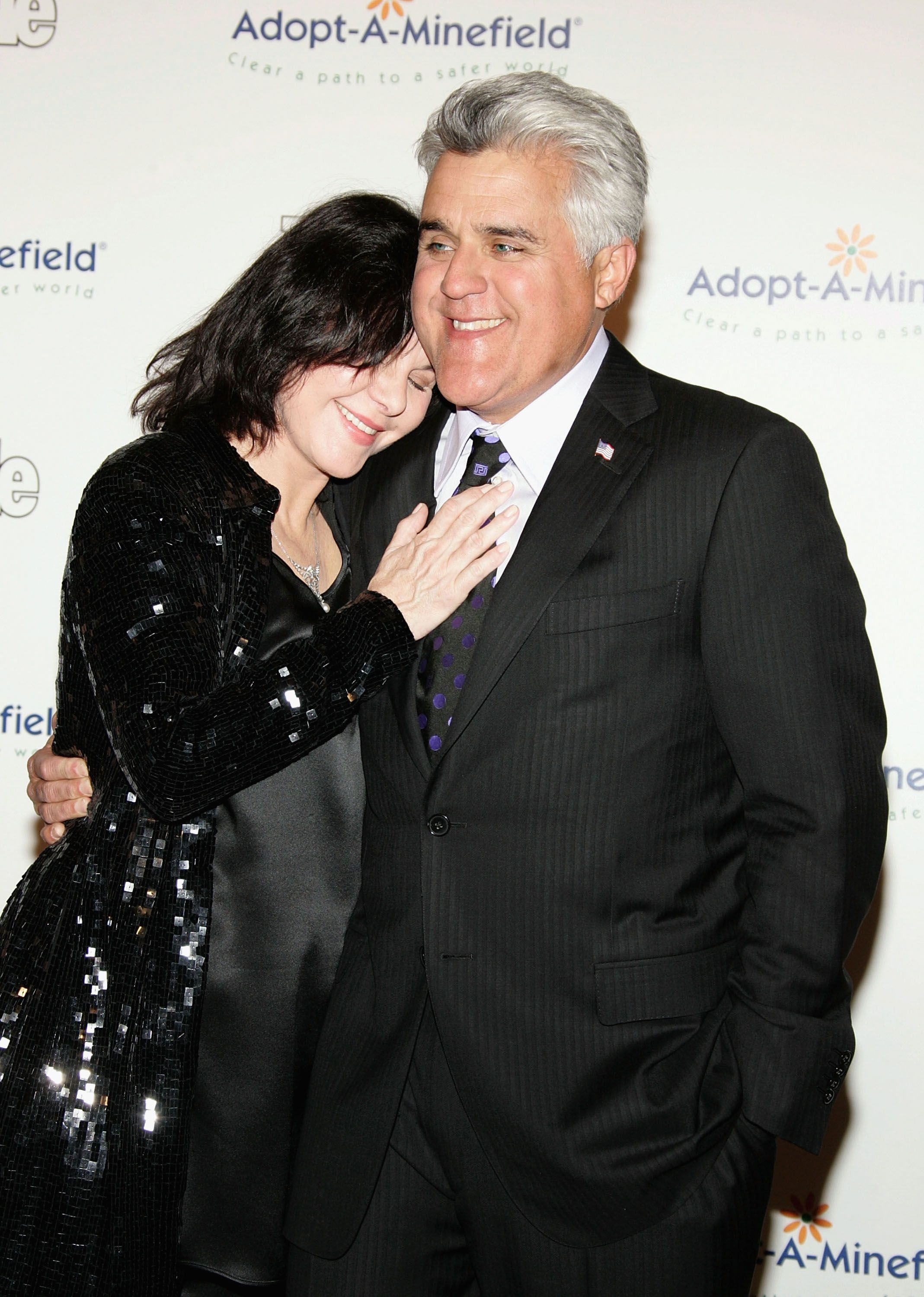 Jay Leno and his wife Mavis Nicholson atthe Fifth Annual Adopt-A-Minefield Gala night on November 15, 2005, in Beverly Hills, California | Photo:Frazer Harrison/Getty Images