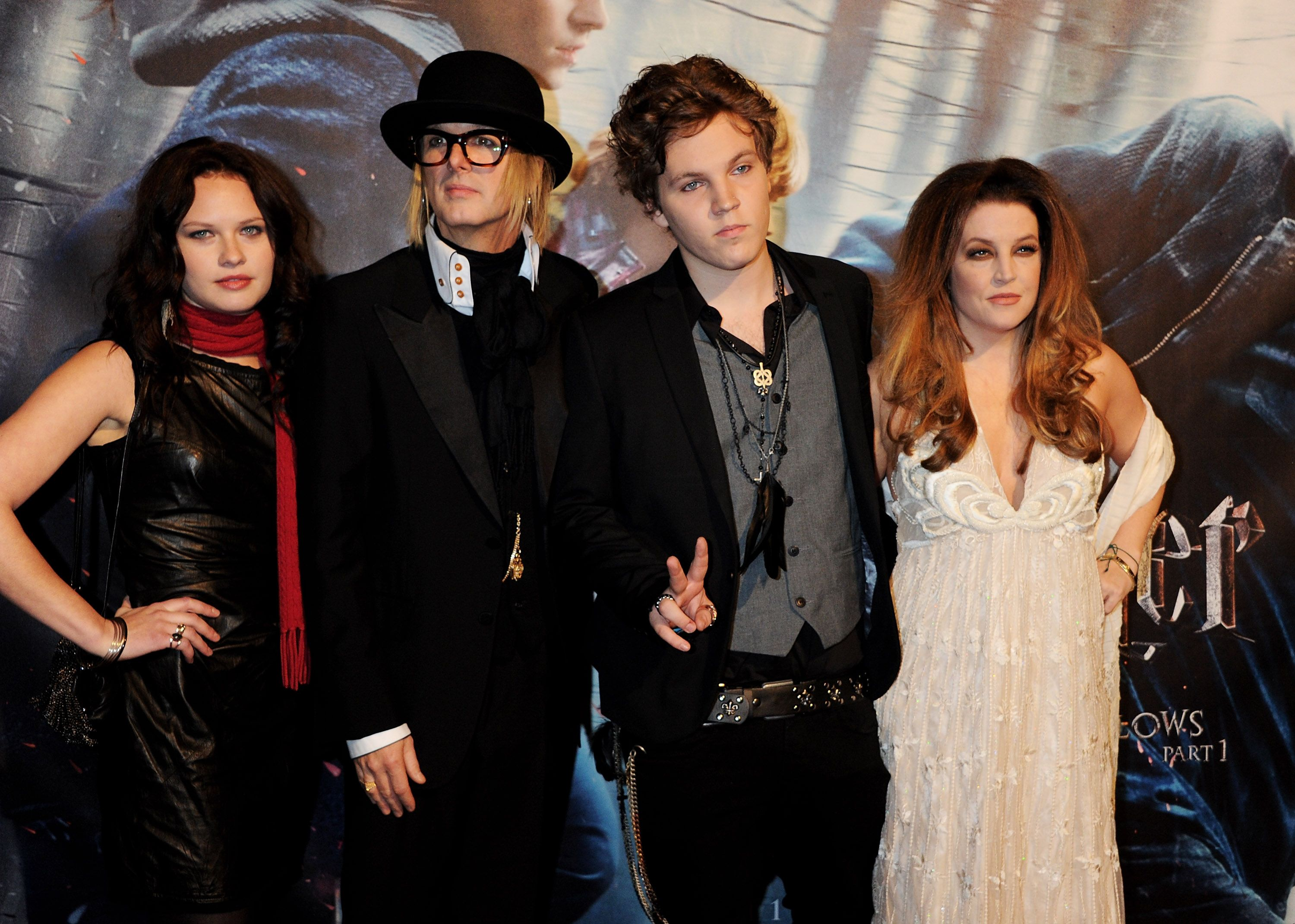 """A guest, Michael Lockwood, Benjamin Keough, and Lisa Marie Presley atthe World Premiere of """"Harry Potter And The Deathly Hallows: Part 1""""on November 11, 2010, in London, England 