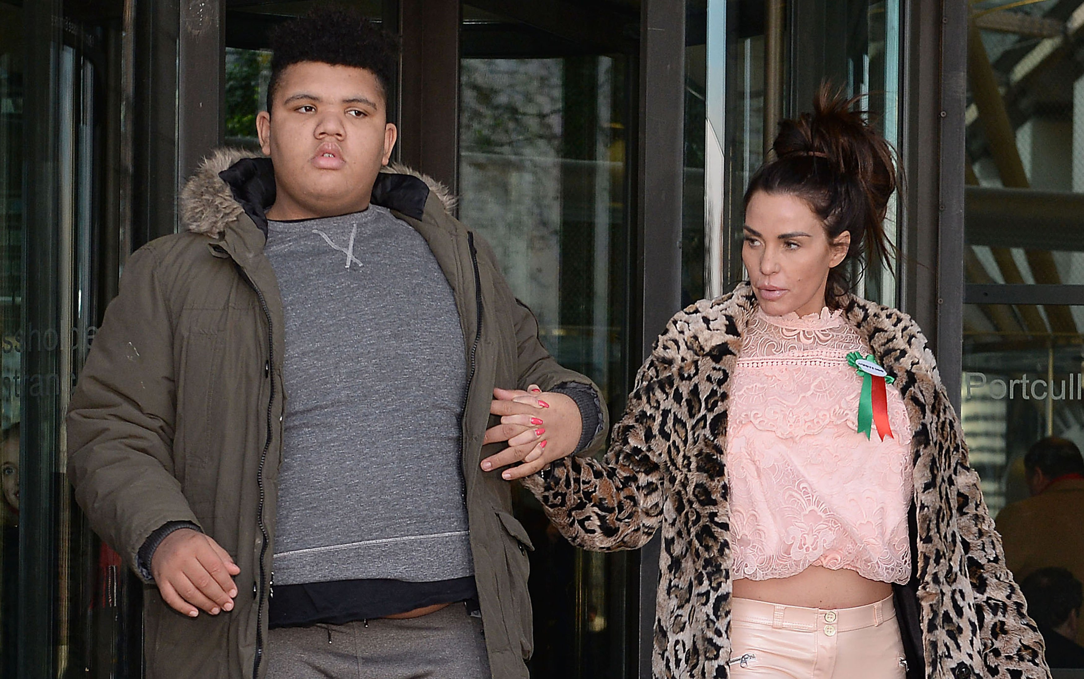 Katie Price and her son, Harvey pictured leaving Portcullis House in London, 2018. | Photo: Getty Images