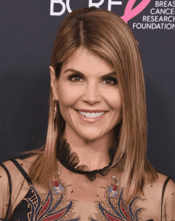 Lori Loughlin poses on the red carpet at The Women's Cancer Research Fund's An Unforgettable Evening Benefit Gala at the Beverly Wilshire Four Seasons Hotel, on February 27, 2018, in Beverly Hills, California | Source: Getty Images (Photo by Jon Kopaloff/FilmMagic)