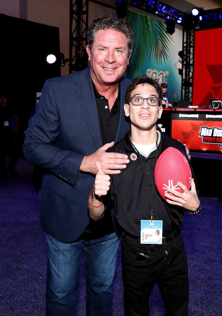 Dan Marino and guest attend day one with SiriusXM at Super Bowl LIV on January 29, 2020 in Miami, Florida. | Source: Getty Images