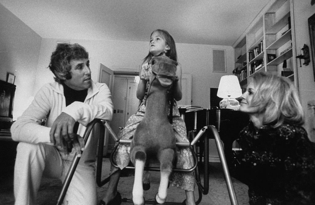 Composer Burt Bacharach Jr. (L) and his actress wife Angie Dickinson watching their daughter ride a rocking horse.   Source: Getty Images