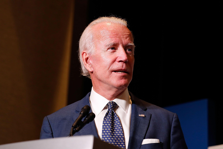 Joe Biden speaks on stage before an audience. | Source: Getty Images