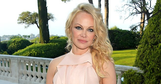 Pamela Anderson, 53, Defies Her Age Posing in a Mini Dress for a Stunning Black & White Photo