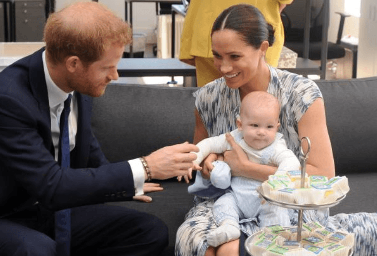 Prince Harry and his wife Meghan Markle hold their baby son Archie as they met with Archbishop Desmond Tutu (unseen) at the Tutu Legacy Foundation, on September 25, 2019, Cape Town South Africa | Source; HENK KRUGER/POOL/AFP via Getty Images