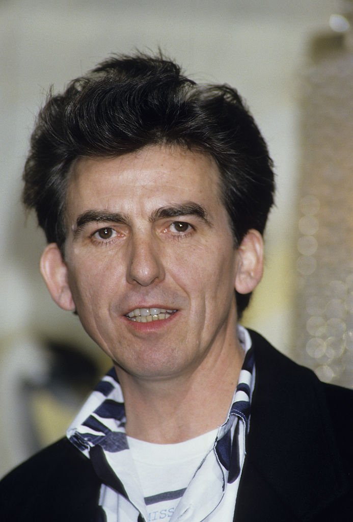 Former Beatle George Harrison holds a press Conference with Madonna for their film 'Shanghai Surprise' at the Kensington Roof Gardens | Getty Images / Global Images Ukraine