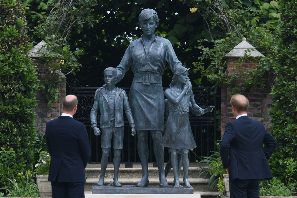 Prince William and Prince Harry unveil a statue of their mother, Princess Diana at The Sunken Garden in Kensington Palace on July 1, 2021, London   Photo: Getty Images