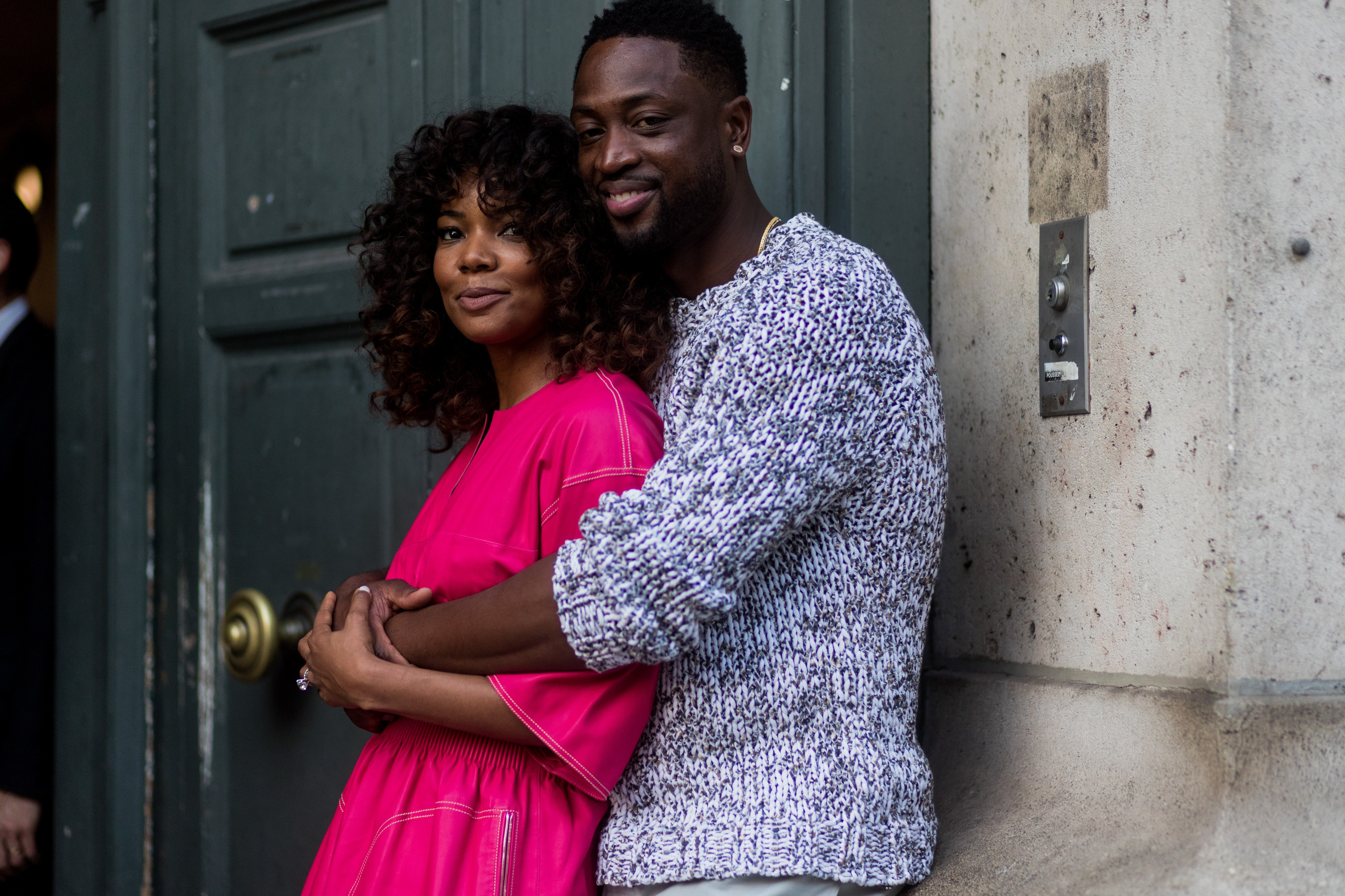 Gabrielle Union and Dwyane Wade hug outside Hermes during Paris Fashion Week in Paris, France on June 24, 2017 | Photo: Getty Images