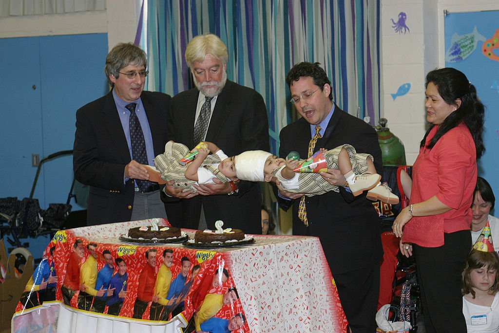 Conjoined twins Clarence and Carl Aguirre are held by their doctors (L to R) Dr. Robert Marion, Dr. James T. Goodrich and Dr. David Staffenberg, along with their mother Arlene at Blythedale Children's Hospital in Valhalla, New York in this undated photo | Photo: Getty Images