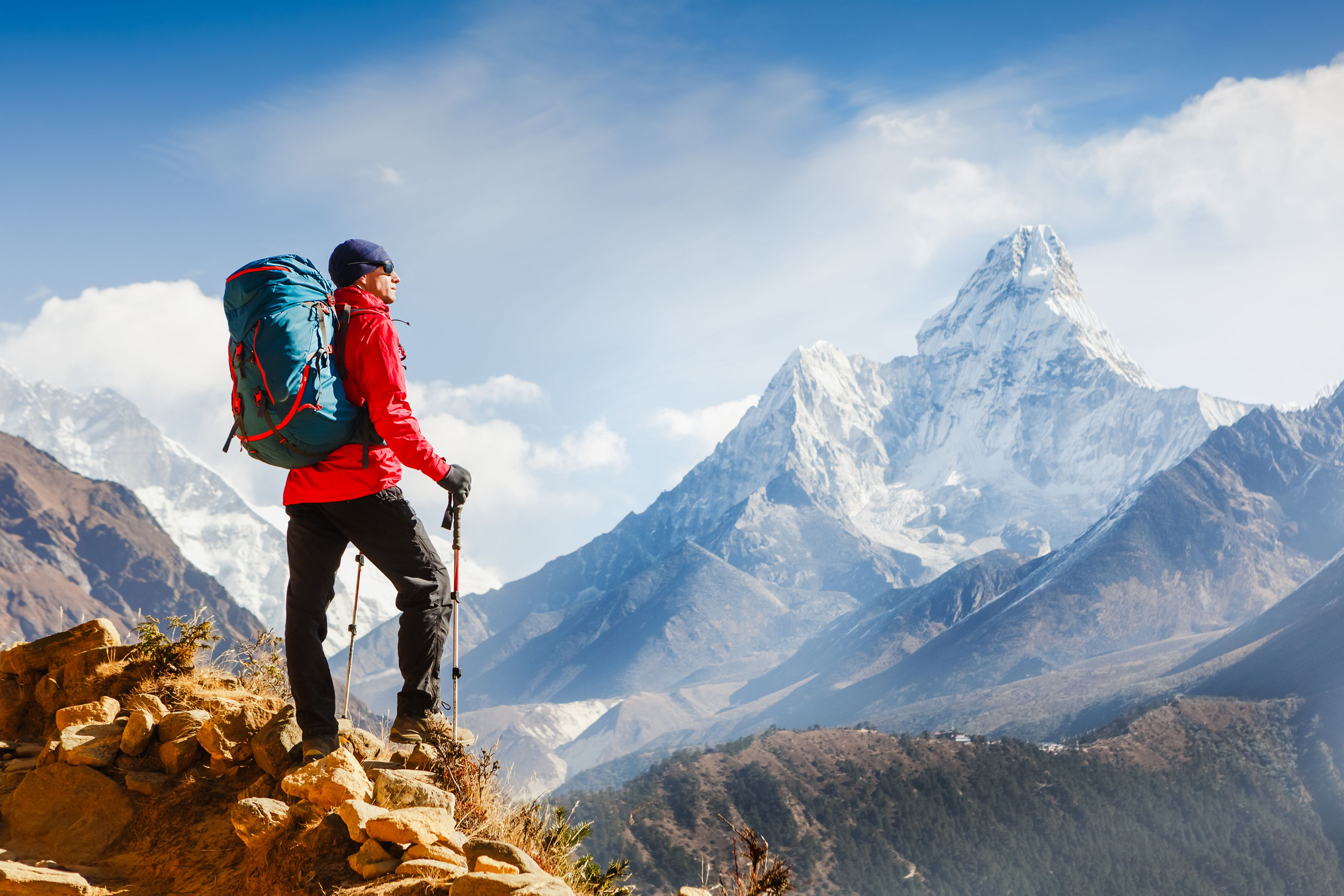 A man looks over a majestic view on top of a mountain.   Source: Shutterstock