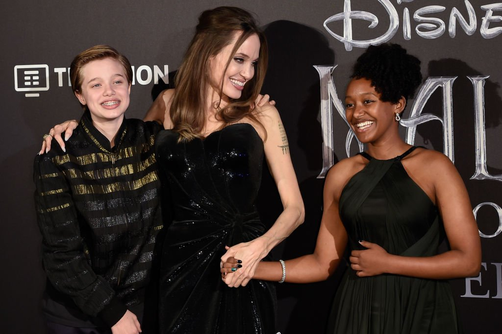 Angelina Jolie and her children Shiloh Nouvel Jolie-Pitt and Zahara Marley Jolie-Pitt during the European premiere of the Disney film Maleficent Lady of Evil on October 7th, 2019 | Photo: Getty Images